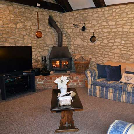 Blake's Barn lounge area with log burner